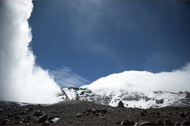 Chimborazo open in blue skies, before the next wave of clouds.