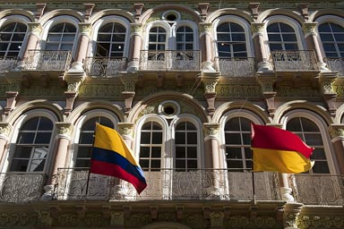 Cuenca, old decorated house, Ecuadorian flag outside.
