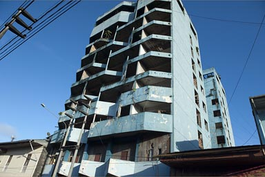 Blue concret high rise, a ruin in Iquitos.