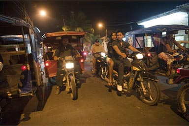 Nightly auto rickshaw, motor cycle taxi ride home, Iquitos Peru.