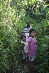 Snakes are everywhere, these children walk barefoot through the mud. Peruvian jungle near Lagunas.
