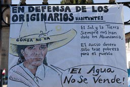 Conga mine protest, Cajamarca poster shows Indigenas woman and hat with Conga no va. El Agua no se vende.