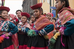 Girls red traditional Andean dress, Independence Day in Peru.