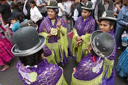 Traditionally dressed women from Puno wait till they dance, Independence Day in Lima, Peru.