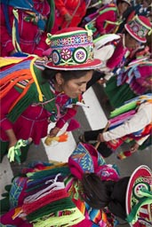 Women from Puno march and dance along parade on plaza de armas, Lima Independence Day in Peru.
