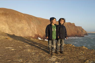 Colored desert, my boys, Paracas, cliffs of Playa Colorada, Peru.