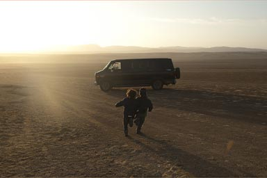 The van and my boys run into late sun and the desert of Paracas, Peru.