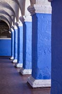 Blue thick columns, white arcades, paintings on ceiling, Santa Catalina, convent, Arequipa.