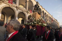 Statue of a Saint is carried around plaza de armas, procession of church in Arequipa. Christian fiesta.