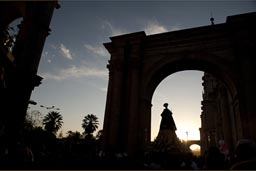 Statue of redeemer is carried under arch of cathedral in Arequipa, plaza de armas, Peru.