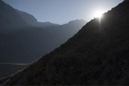 Sun, first rays of light over Colca Canyon walls as we ride up on mules.
