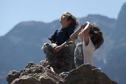 In Colca Canyon my two boys raise their heads and watch the giant Condors glide over. Peru.