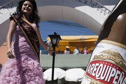 On Arequipena (beer) truck, the beauty and the beer. Arequipena Day, Peru.