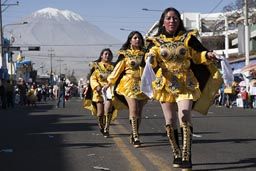 In back of Avenida de Independencia is Volcan Misti, parade on Arequipa Day.