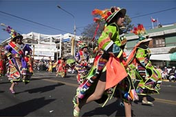 Some groups rush by, in an Andino run, parade on Arequipa Day, Peru.