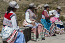 Mirador, Cruz del Condor, 4 traditionally dressed Indigenous women. Peru.
